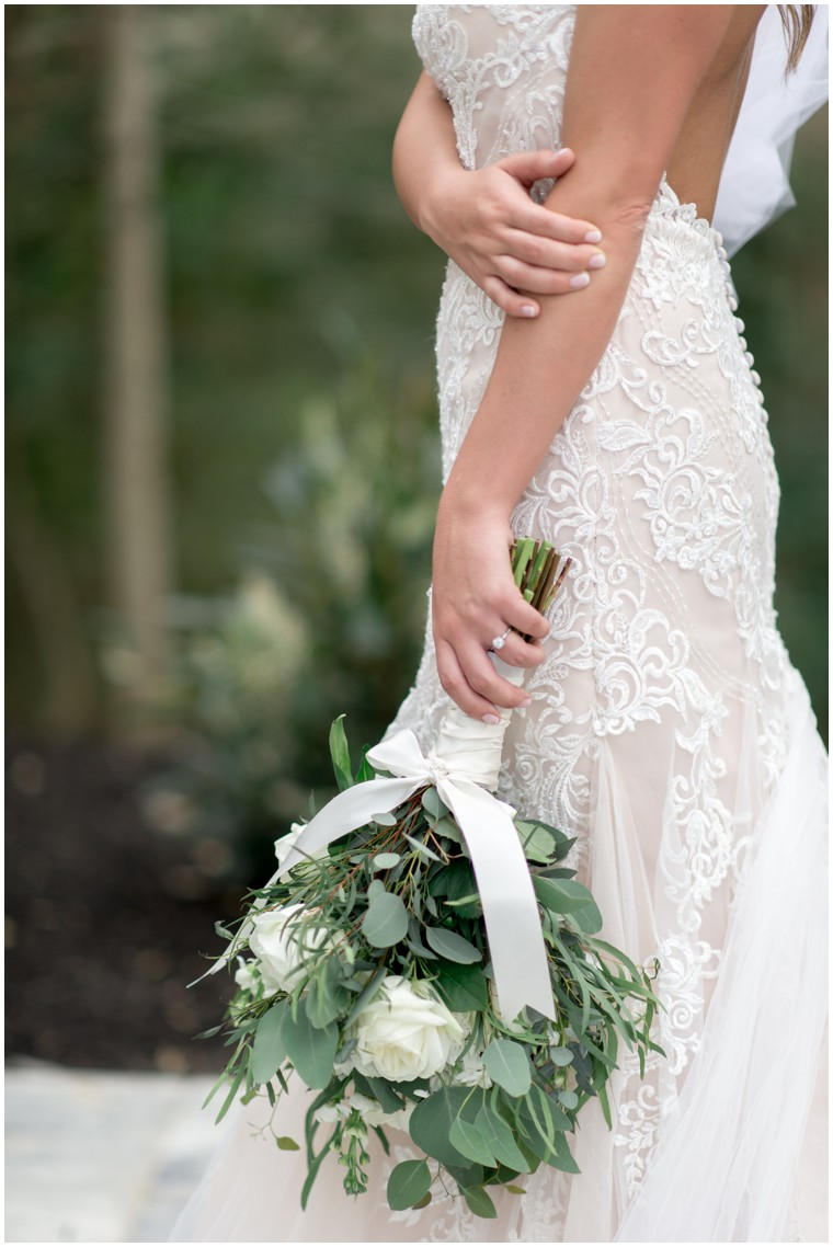 green and white bridal bouquet, lace and tulle wedding dress