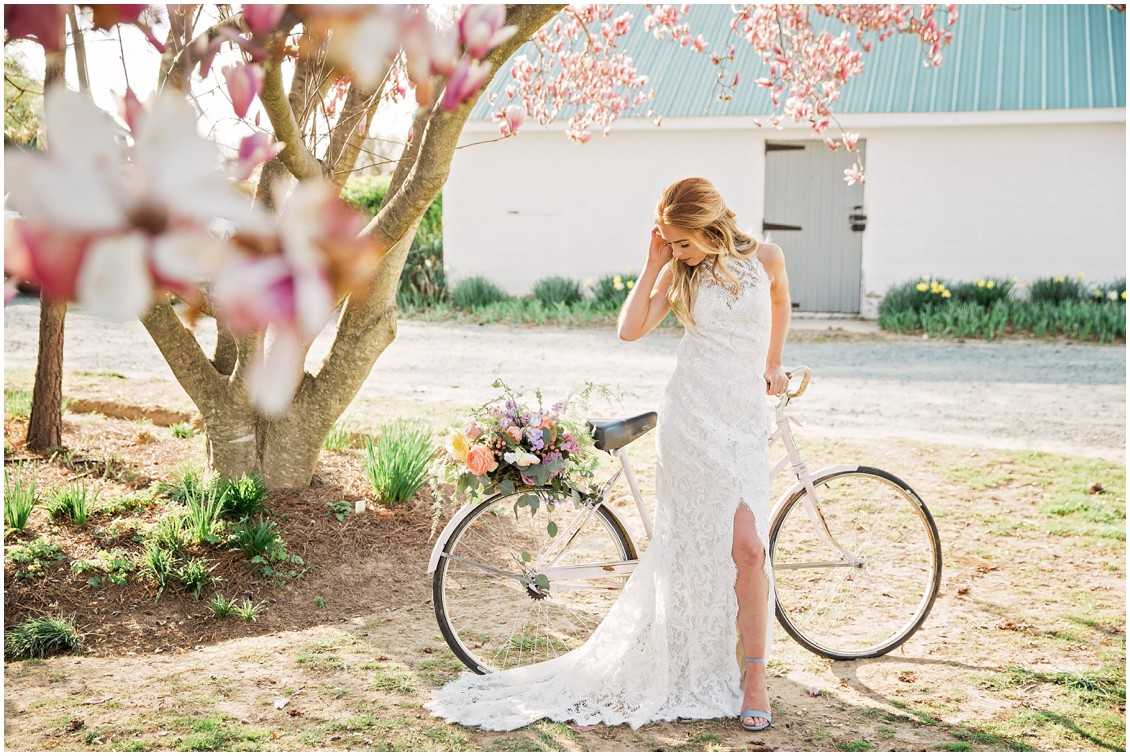 Beautiful bride poses with beach cruiser bike for a Garden Party Wedding Styled-Shoot on Maryland's Eastern Shore