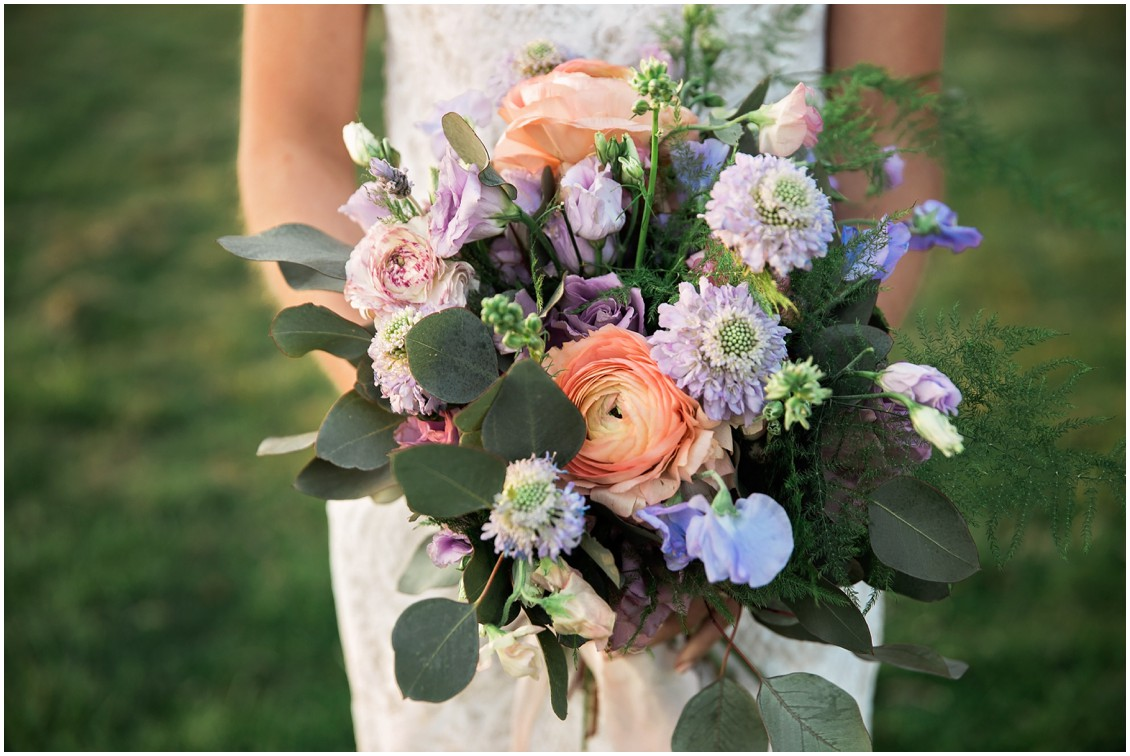 Bride holds pastel hued bouquet made by Sherwood Florist for a Garden Party Wedding Styled-Shoot on Maryland's Eastern Shore