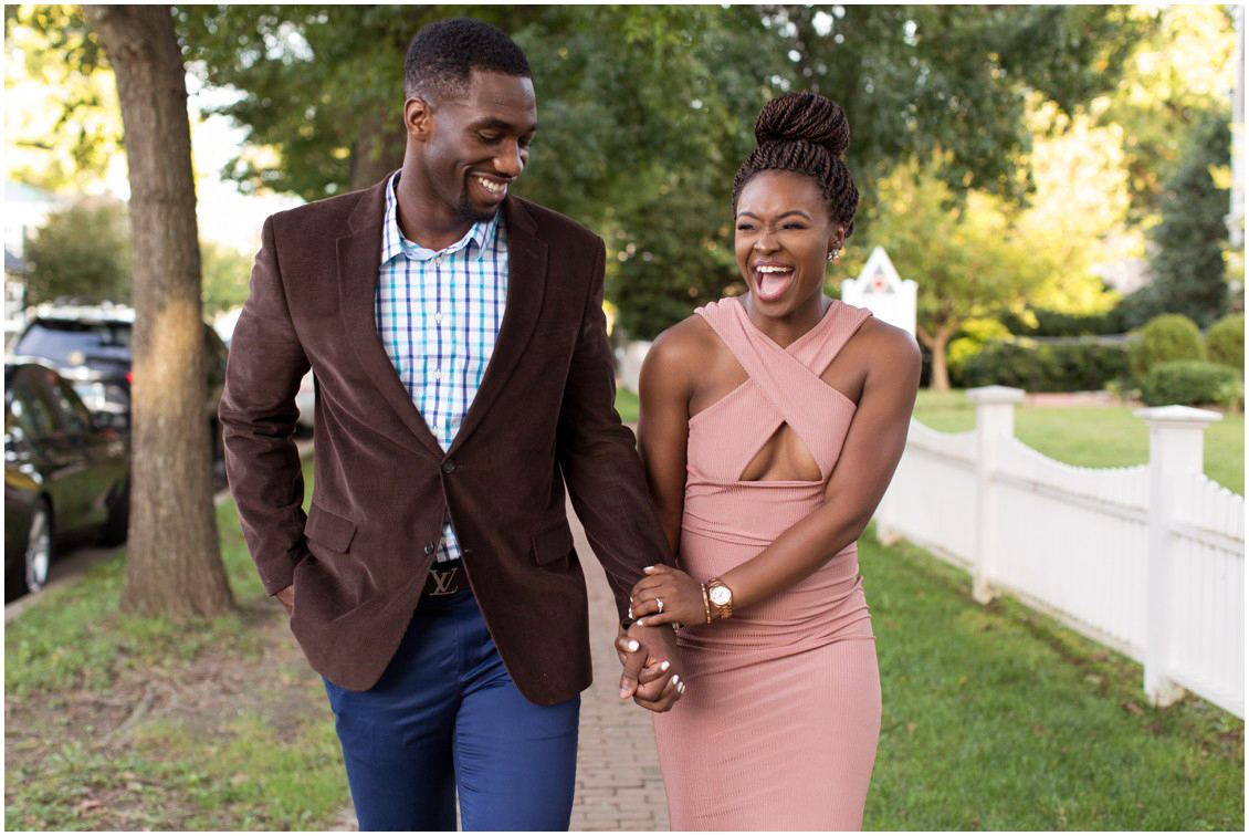 Attractive couple celebrate their engagement while walking hand in hand through downtown Easton, Maryland.