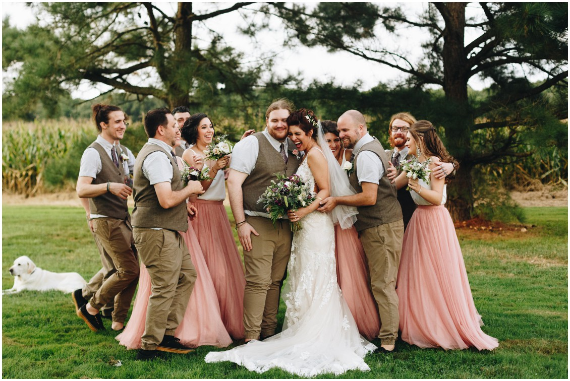 After vows groom and bridal party celebrating beside cornfield. |Eastern Shore Wedding|