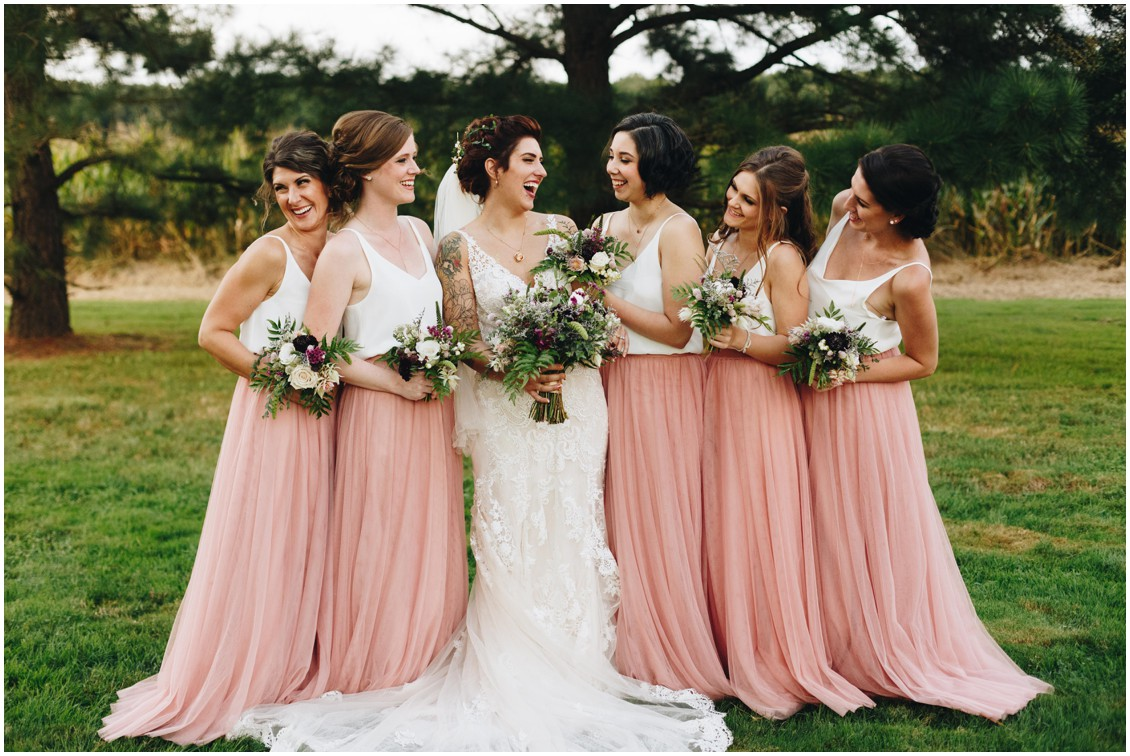 Bride and bridesmaids holding bouquets by Keleidoscope Custom Florals + Butterbee Farm, bride's dress by Wren Bridal, and bridesmaid's dresses by Revelry. |Eastern Shore Wedding|