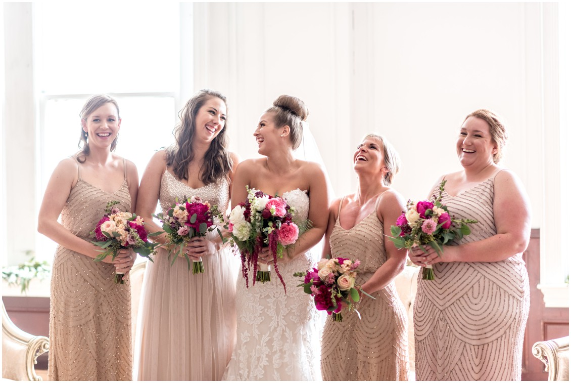 Bride with her bridesmaids holding their brightly colored wedding bouquets. | My Eastern Shore Wedding |