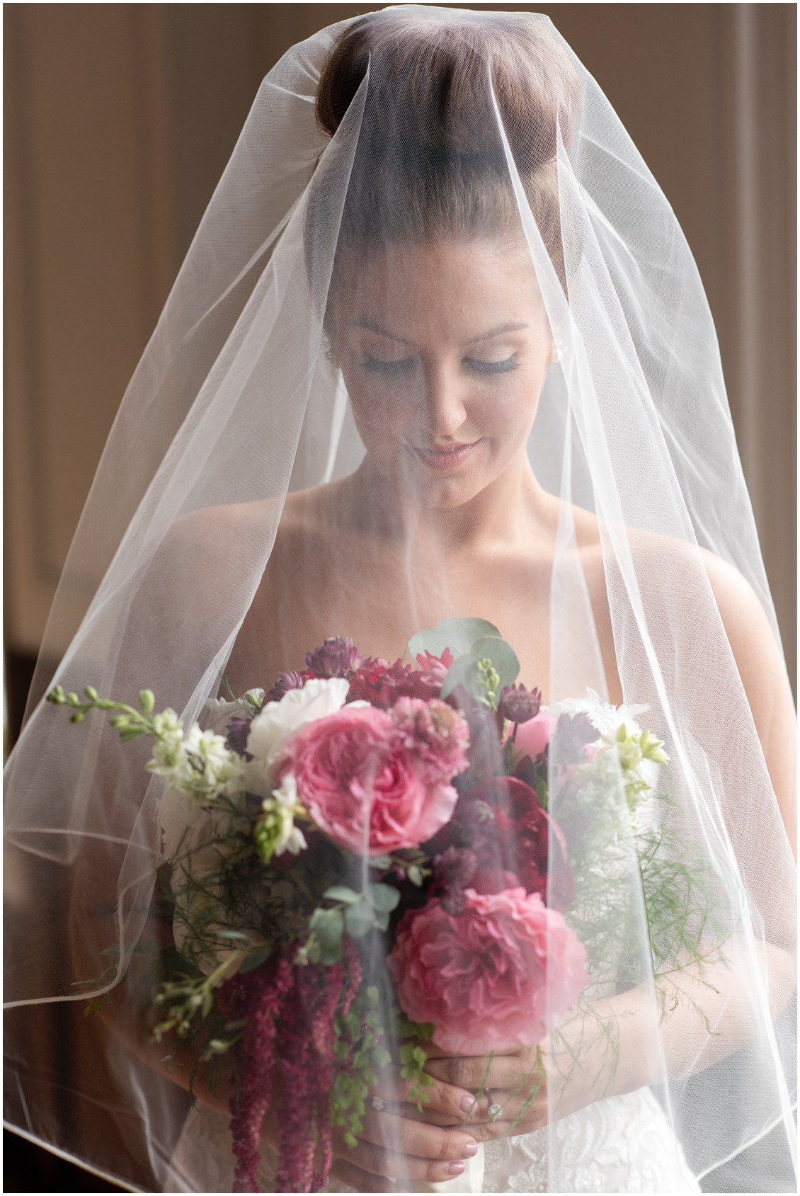 Jacqueline Case hairstyle, Sherwood Florist bouquet, and wedding vale over bride. | My Eastern Shore Wedding |