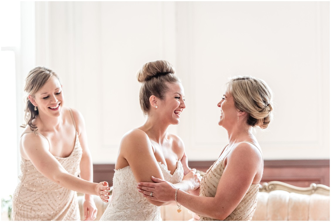 Bride laughing with her bridesmaids, Jacqueline Case hairstyles. | My Eastern Shore Wedding |