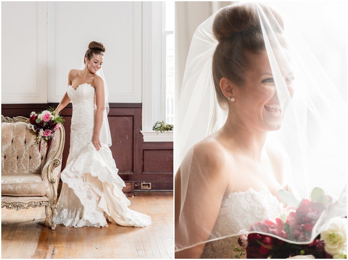 Bride in her strapless wedding gown, big bun hairstyle, and wedding vale over the bride. | My Eastern Shore Wedding |
