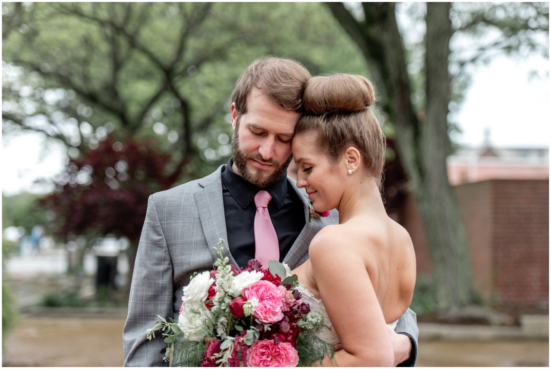 Bride and groom, pink tie, and pink flowers. | My Eastern Shore Wedding |