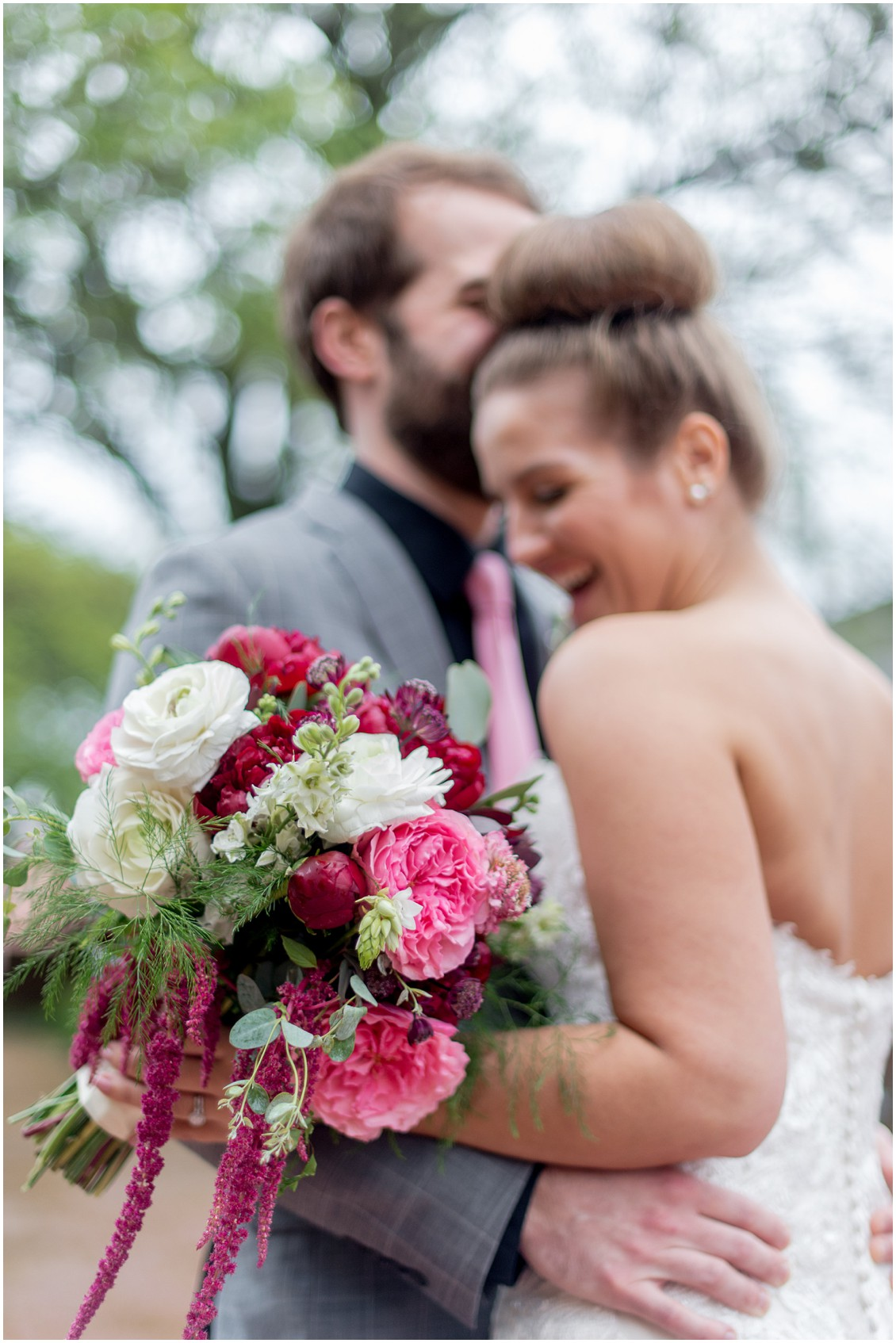 Close-up shot of the Sherwood Florist wedding bouquet filled with pink hued flowers. | My Eastern Shore Wedding |