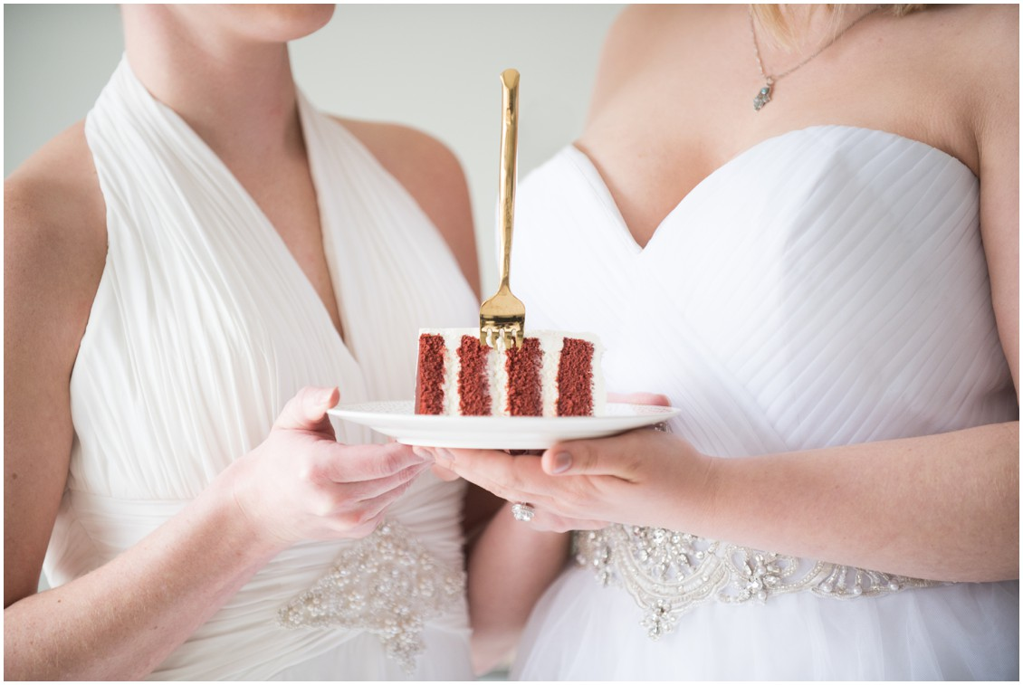 Brides Hold Wedding Cake