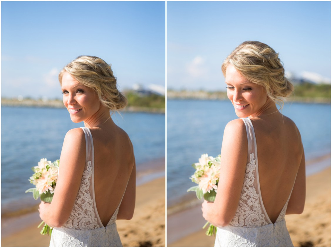 Bride holding Lilac & Page floral bouquet by the water on the beach. | My Eastern Shore Wedding |