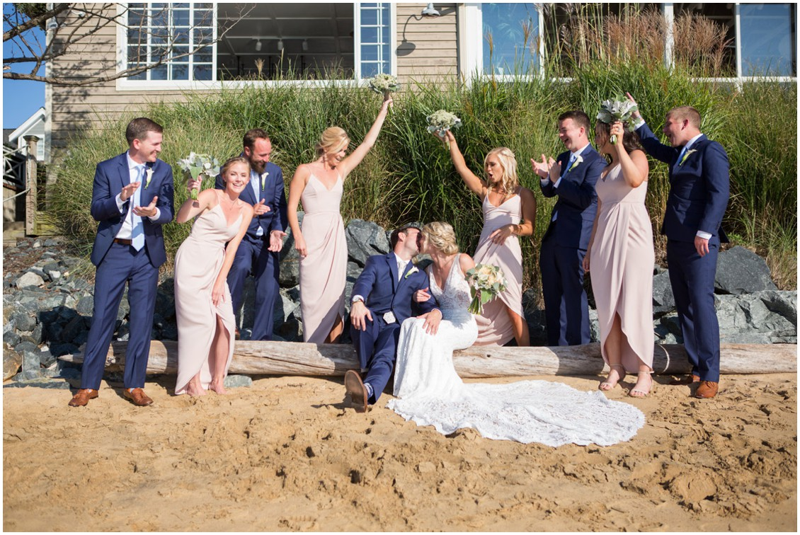 Bridal party celebrating on the beach. | My Eastern Shore Wedding |