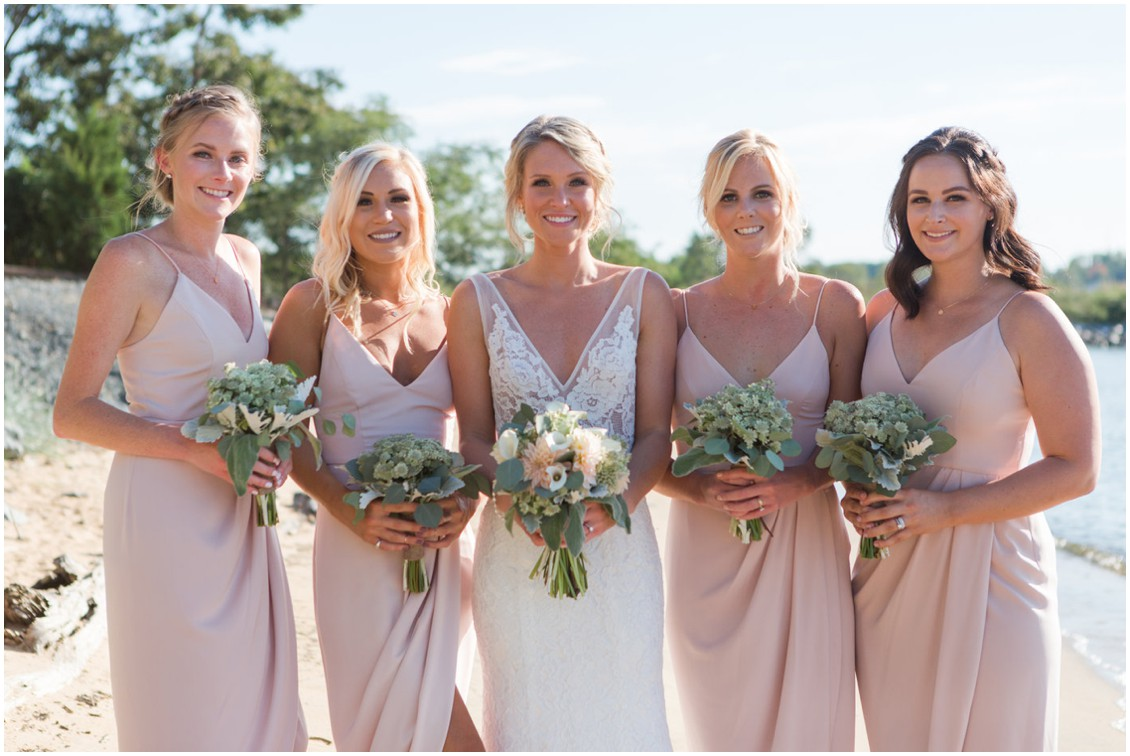 Bride with her bridesmaids on the beach, Shona Joy bridesmaids dresses and Made with Love Bridal wedding dress. | My Eastern Shore Wedding |