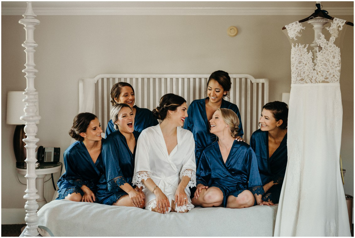 Bride with her bridesmaids, getting ready in matching silk bathrobes. | My Eastern Shore Wedding |