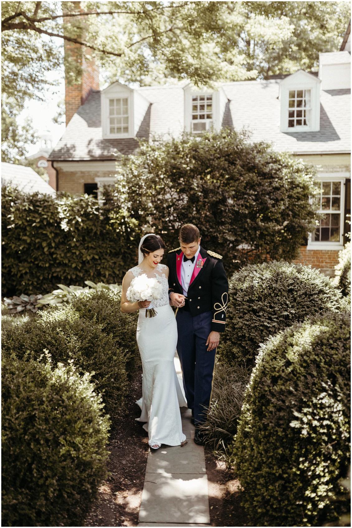 Bride and groom walking through a courtyard. | My Eastern Shore Wedding |