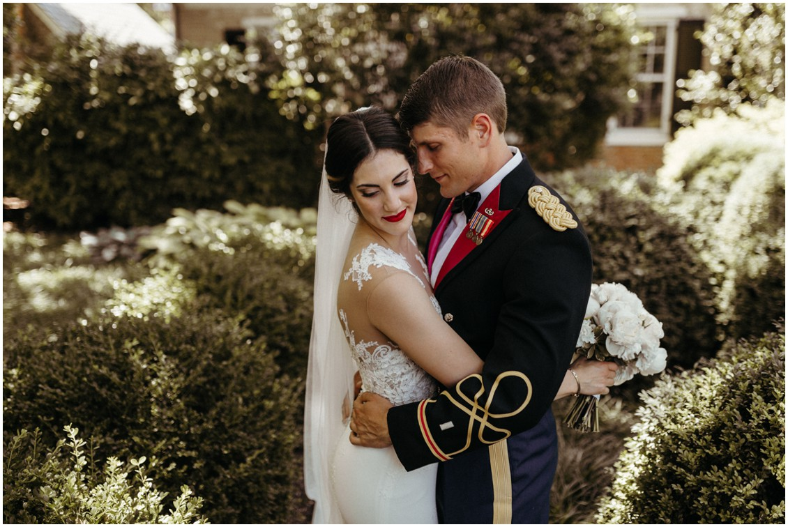 Bride and groom embracing in sunny courtyard. | My Eastern Shore Wedding |