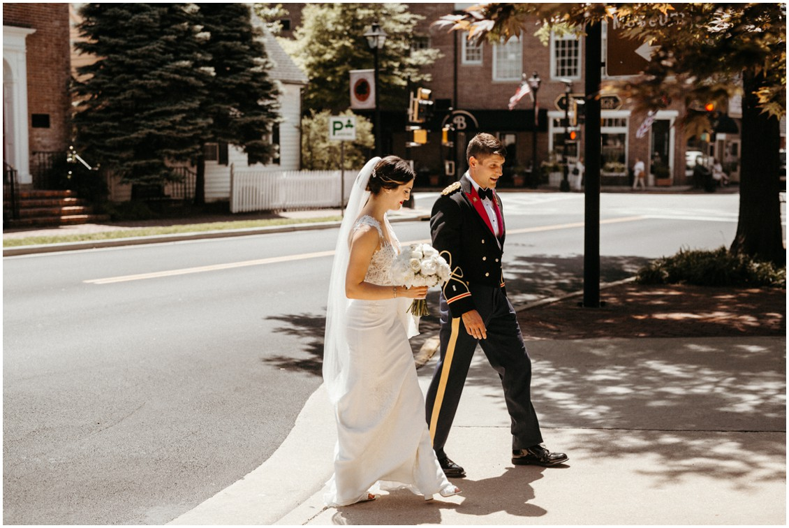 Bride and groom walking through town of Easton, Maryland. | My Eastern Shore Wedding |