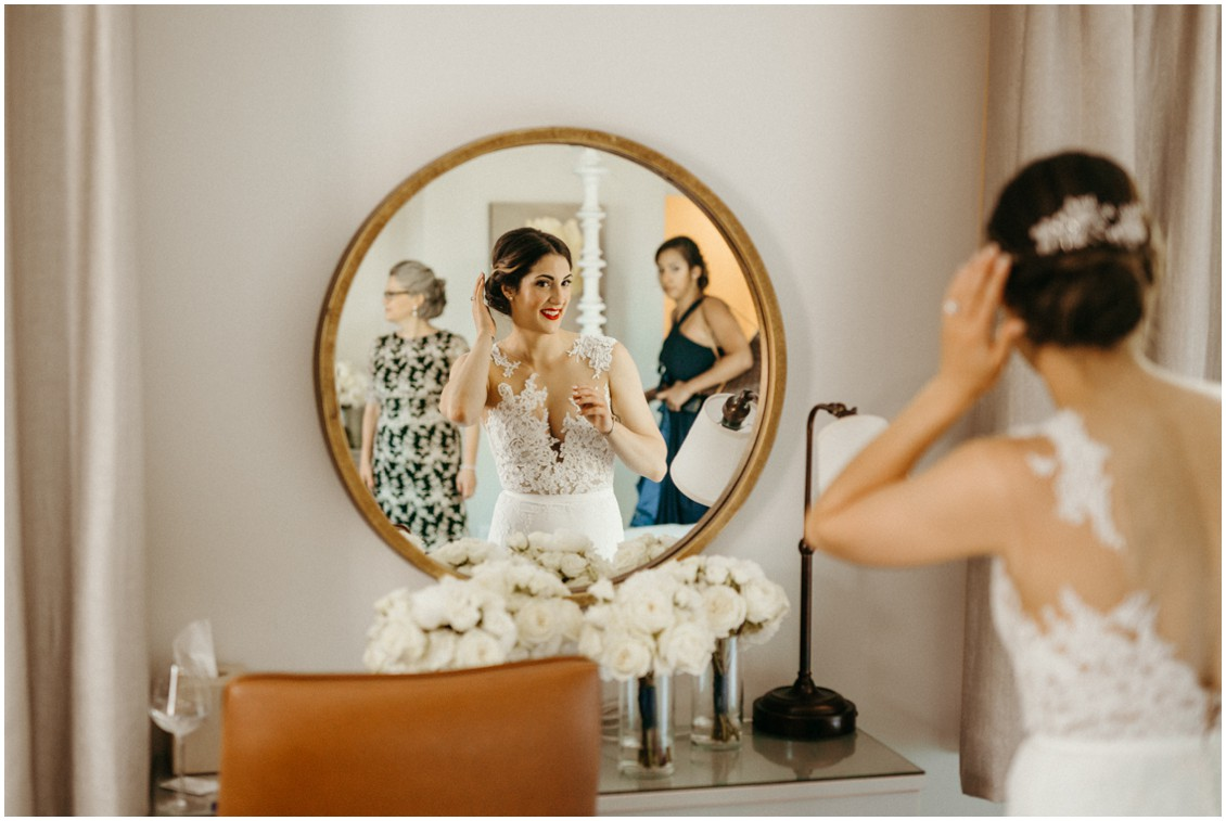 Bride making some finishing touches in the mirror. | My Eastern Shore Wedding |