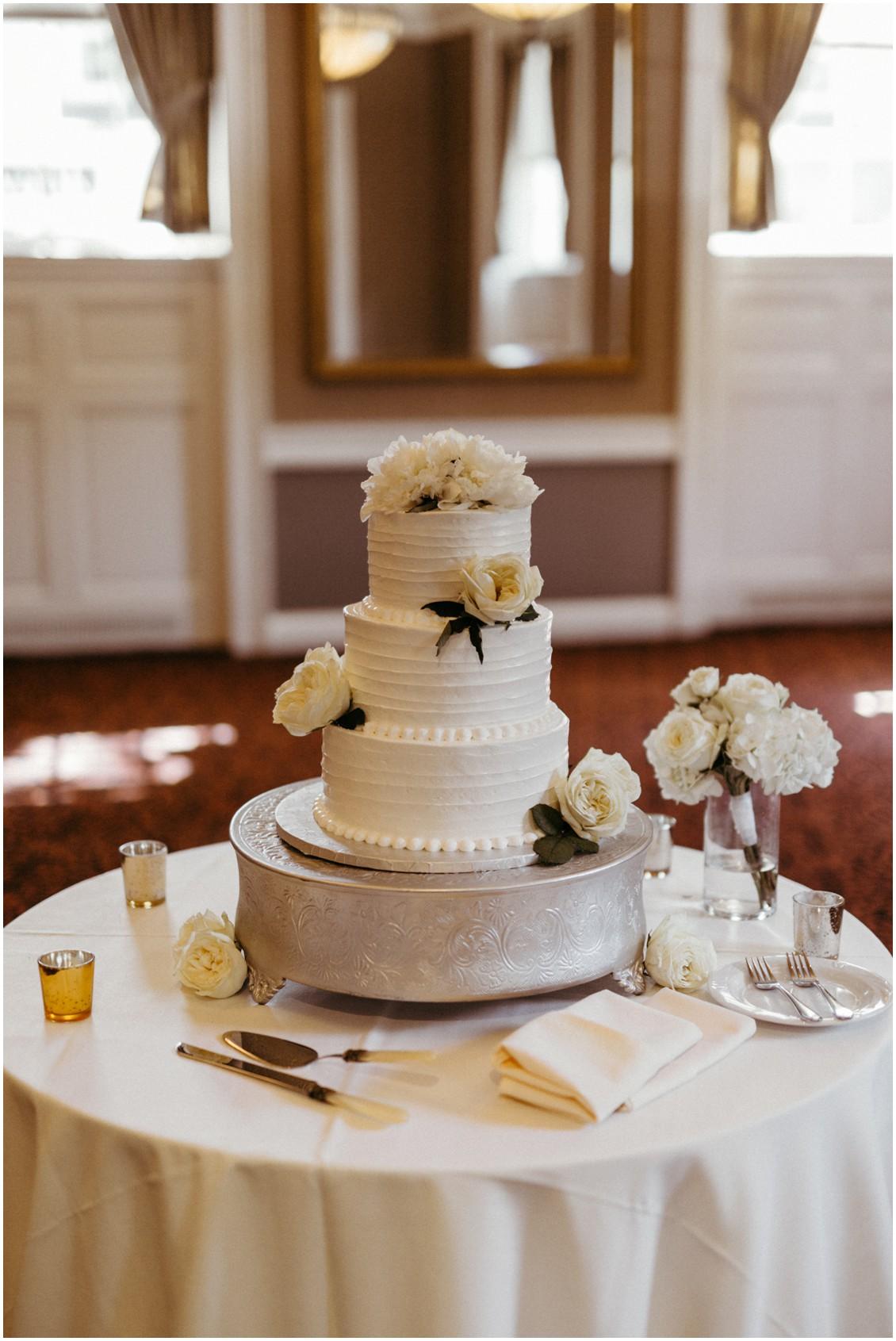 White peonies and roses on white wedding cake. | My Eastern Shore Wedding |