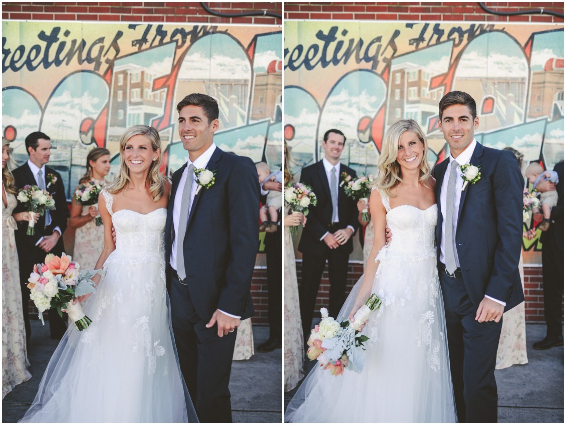 "Bride and groom in front of ""Greetings From Ocean City"" sign. 