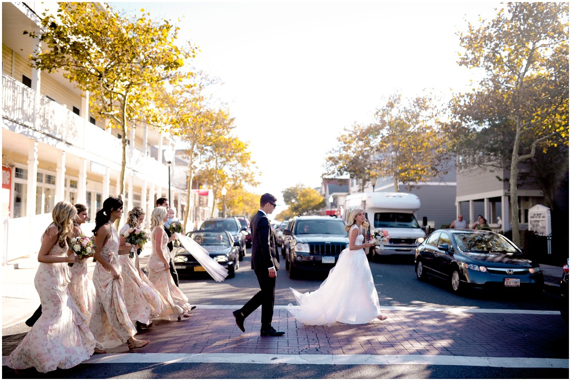 Bridal party walking through the cross walk in Ocean City, MD. | My Eastern Shore Wedding |