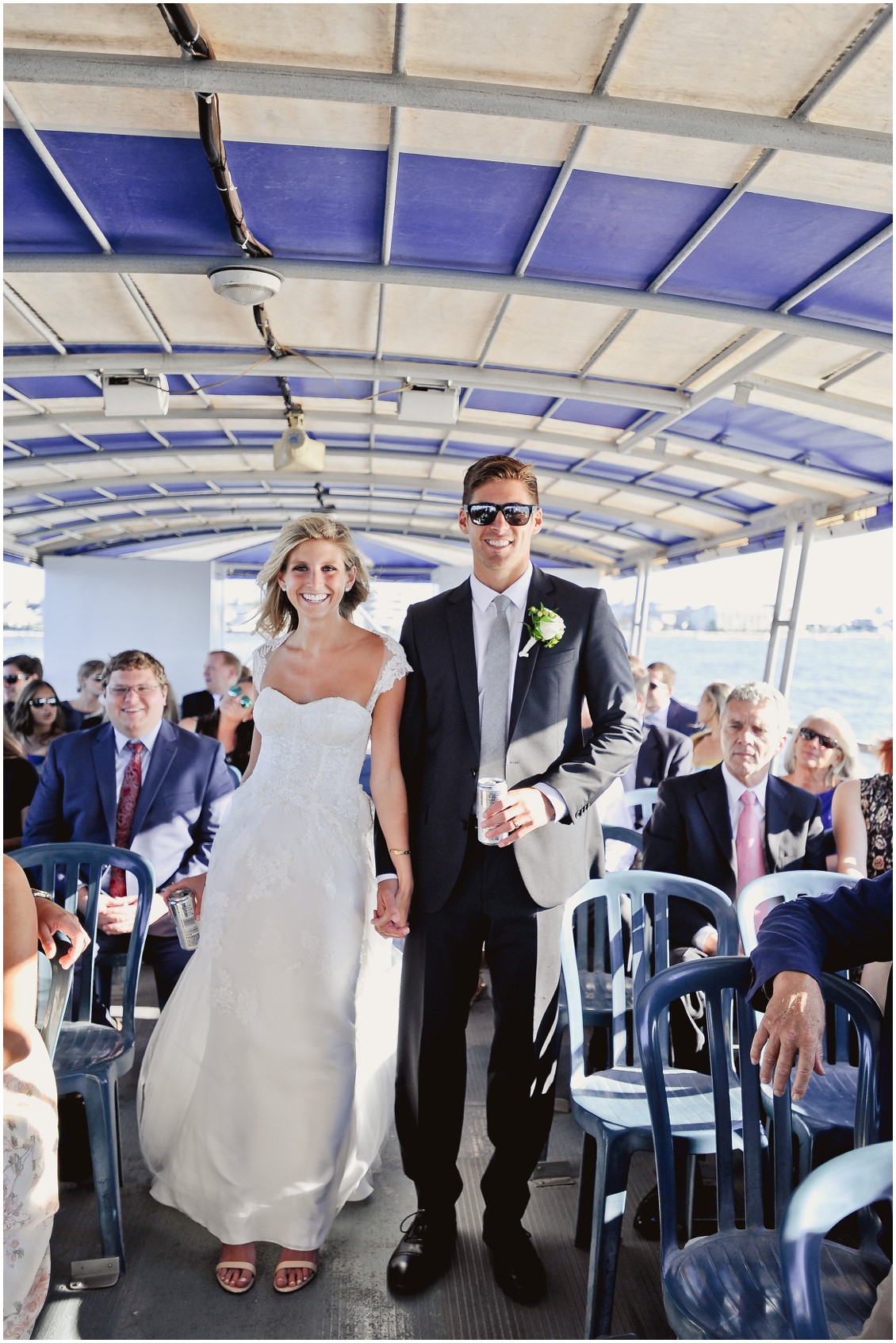 Bride and groom on ferry boat with guests. | My Eastern Shore Wedding |