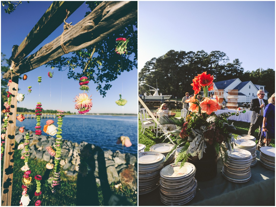 Multi-colored hanging flowers from driftwood and hibiscus centerpiece. | My Eastern Shore Wedding |