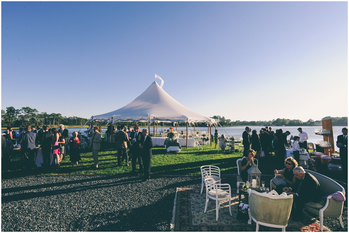 Wedding reception on the water with a large white tent.| My Eastern Shore Wedding |