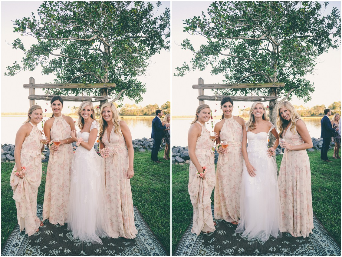 Bride and bridesmaids on an outdoor rug, in front of hanging flowers. | My Eastern Shore Wedding |