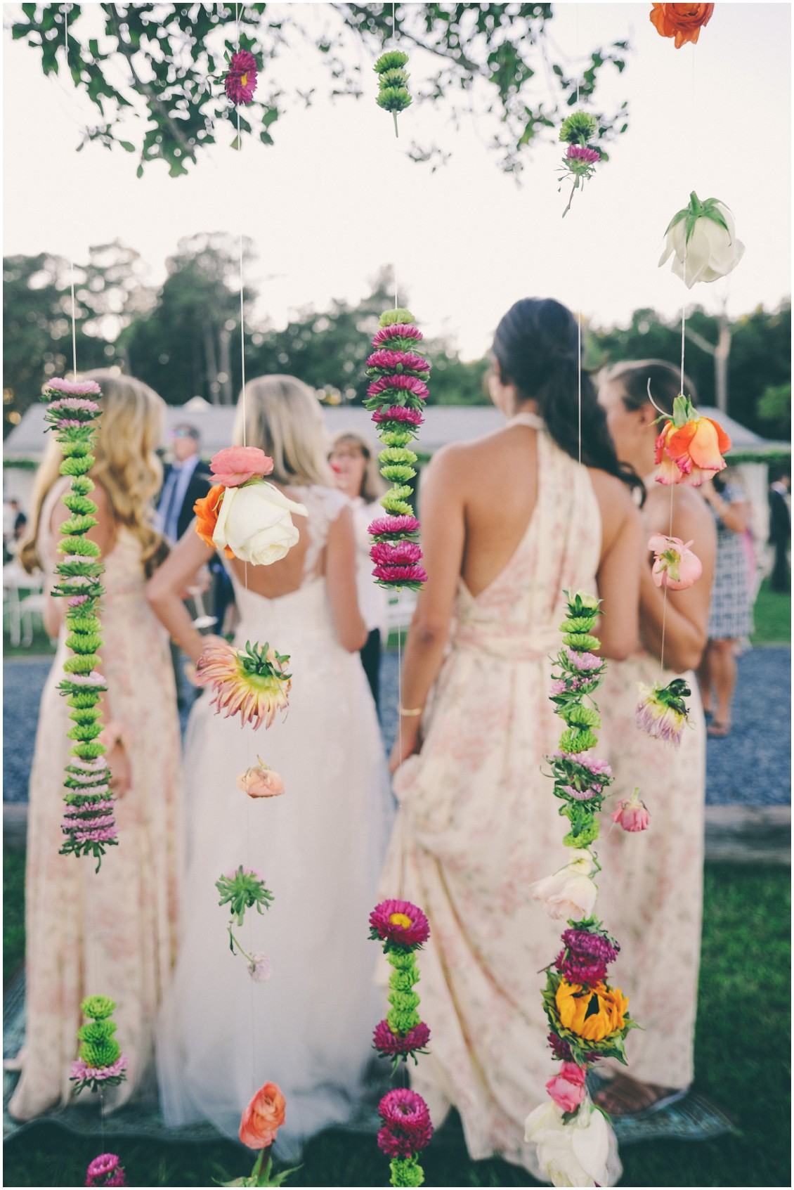 Vibrant, multi-colored hanging flowers by Flowers by Alison. | My Eastern Shore Wedding |