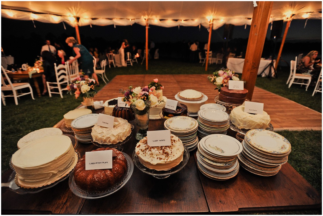A large selection of cake and mix-matched china plates. | My Eastern Shore Wedding |
