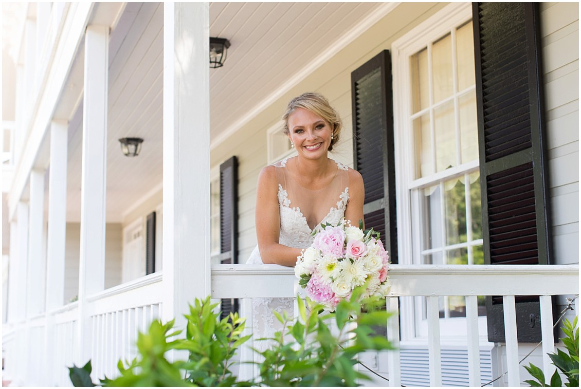 Bride on the porch of the Historic Kent Manor Inn in Stevensville, MD. | My Eastern Shore Wedding |