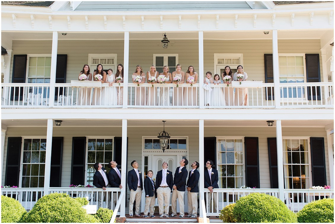 Bridal party on the top and bottom porches of the Historic Kent Manor Inn in Stevensville, MD. | My Eastern Shore Wedding |