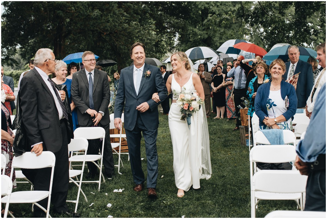 Rainy day wedding ceremony, father walking bride down the aisle. | My Eastern Shore Wedding |