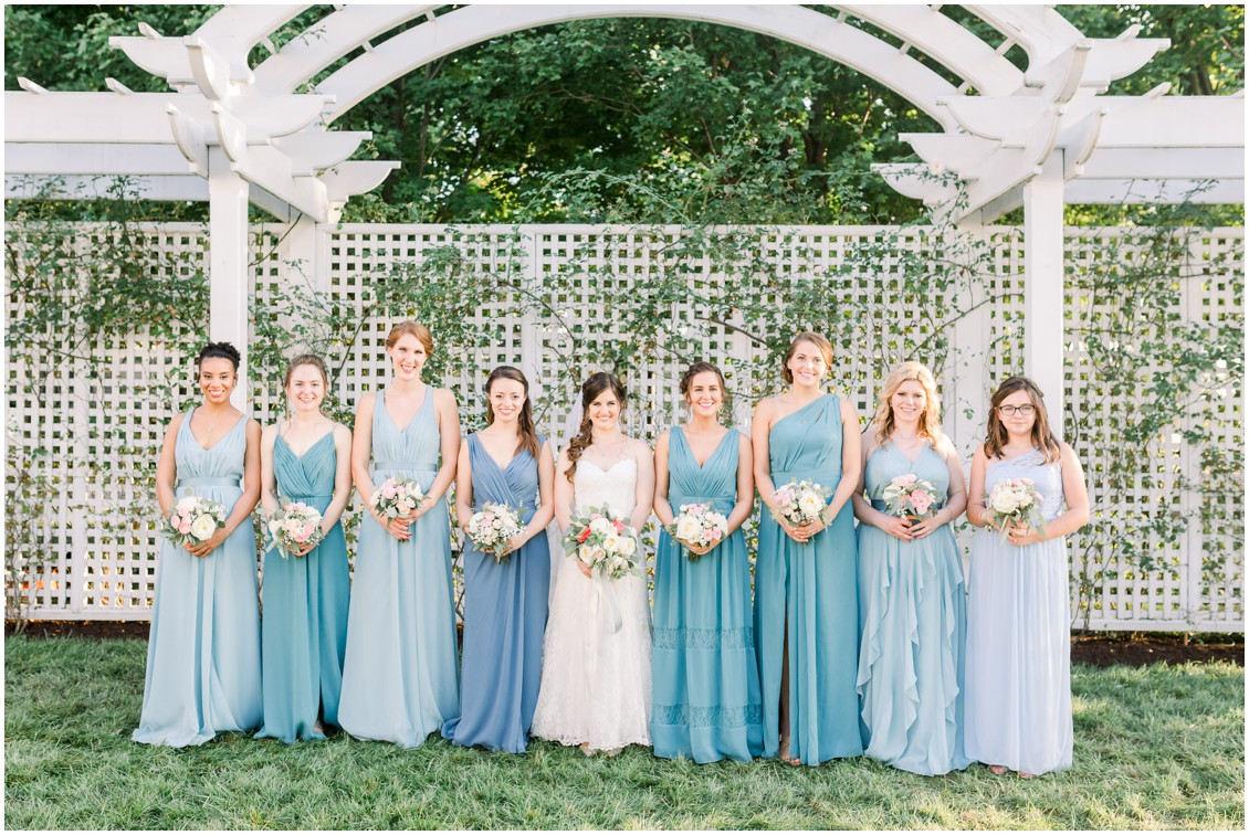 Bride with her bridesmaids, holding flower bouquets by Floret & Vine. | My Eastern Shore Wedding |