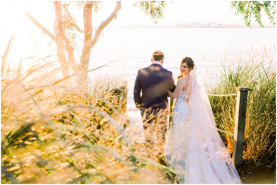 Bride and groom walking down to the beach together at sunset. | My Eastern Shore Wedding |