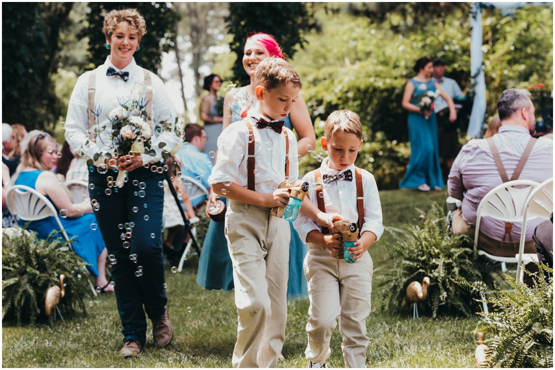 Kids blowing bubbles from bubble guns down the aisle. | My Eastern Shore Wedding |