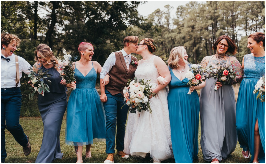 Couple kissing, surrounded by wedding party. | My Eastern Shore Wedding |