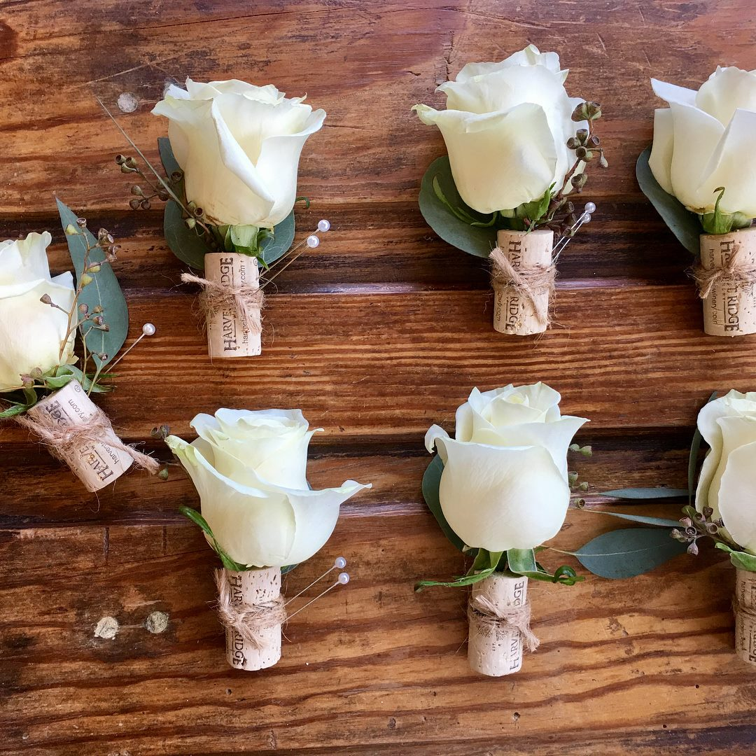 White rose and wine cork boutonnières made by Chesapeake Blooms on the Eastern Shore