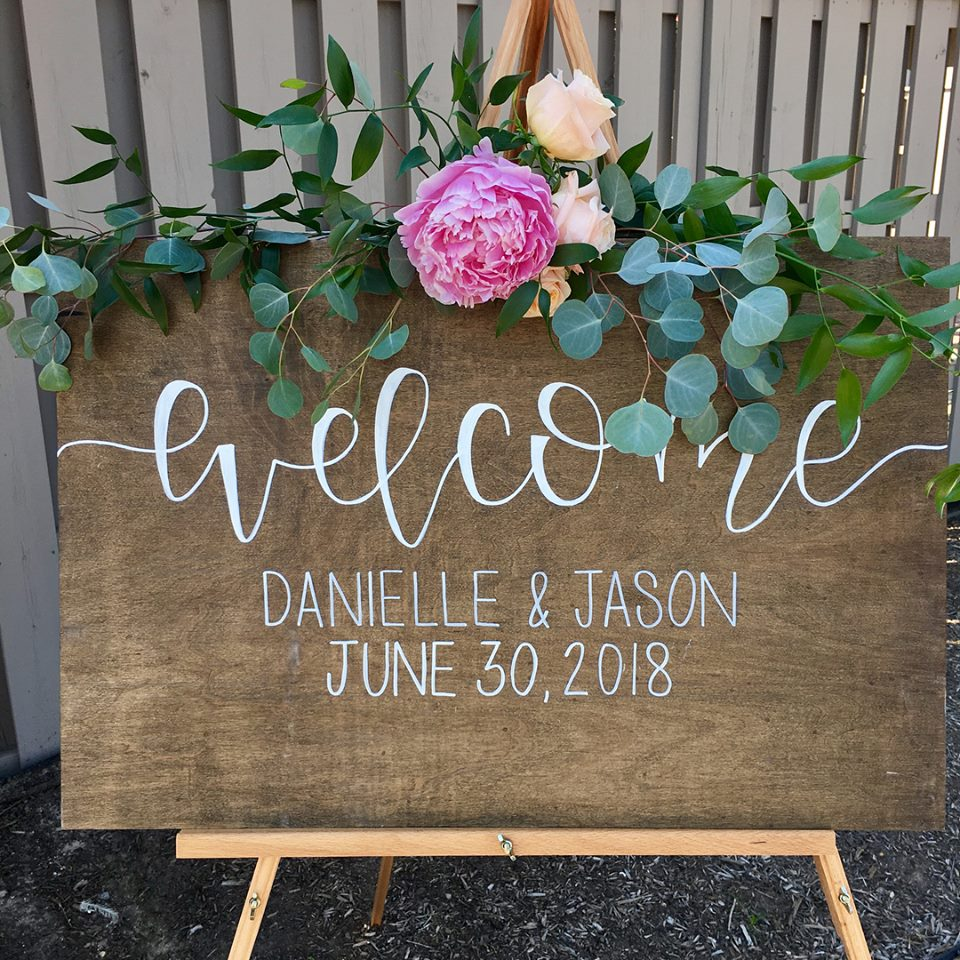 Wedding Welcome Sign Decorated with Greenery created by Chesapeake Blooms