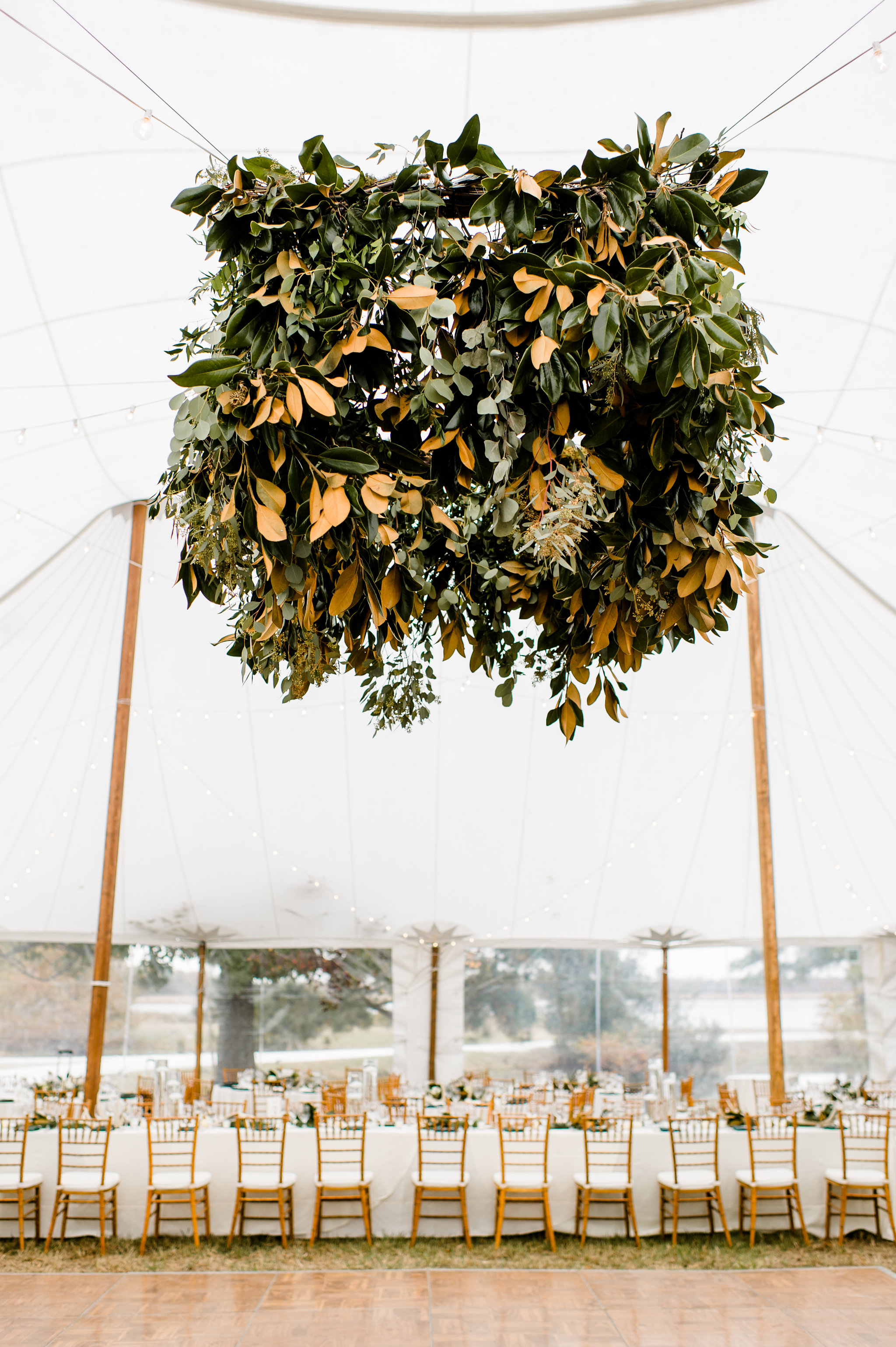 Close Up of Eucalyptus Leaf Chandelier hanging in Wedding Reception tent on Maryland's Eastern Shore