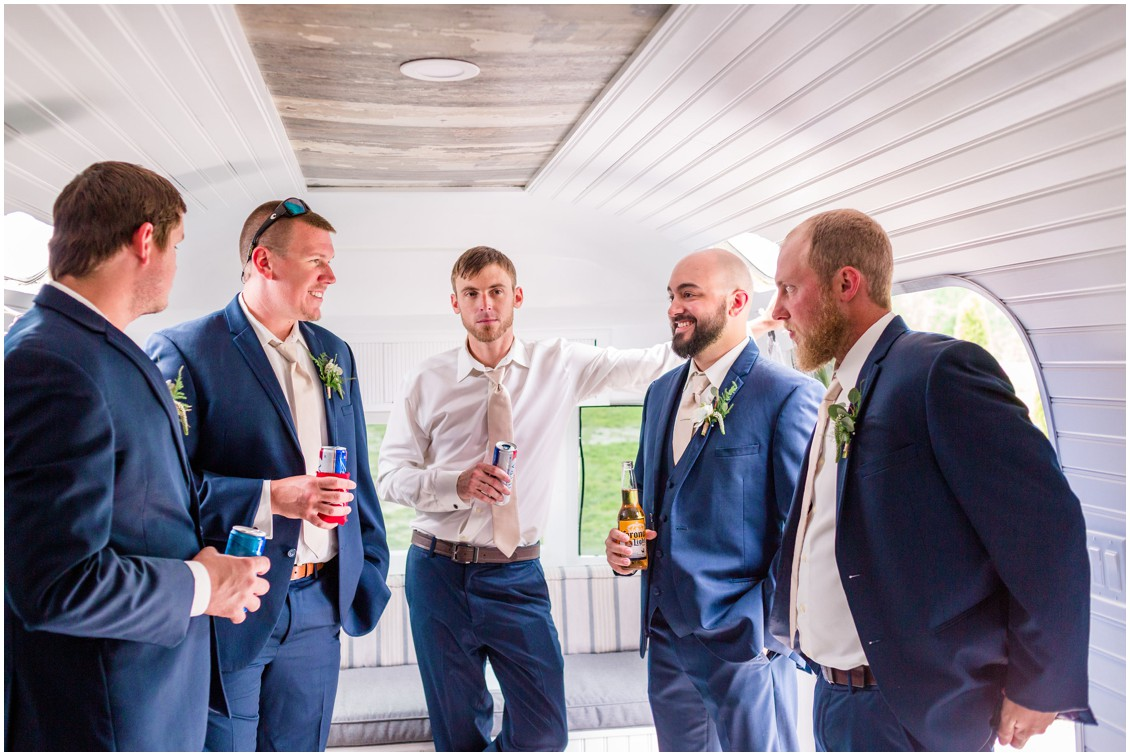 Groom and his groomsmen get ready in small mobile trailer. | My Eastern Shore Wedding |