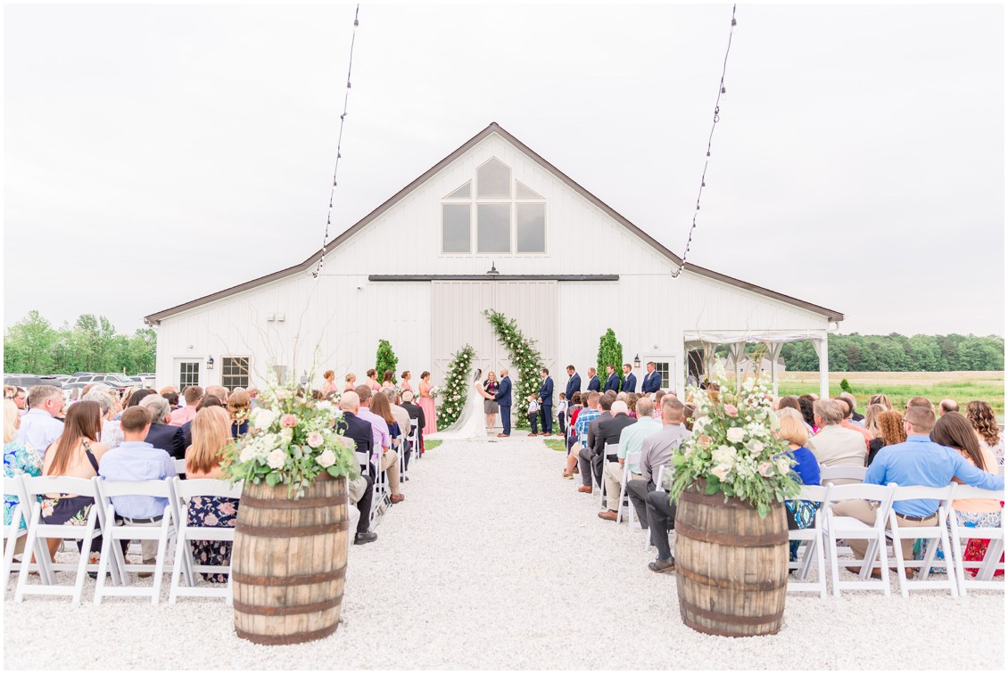 Bride and groom exchanging vows in front of Kylan Barn. | My Eastern Shore Wedding |
