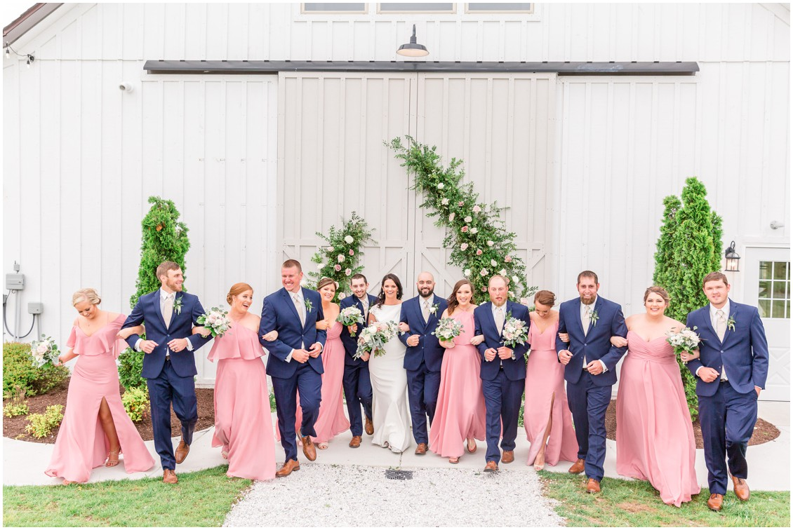 Bridal party walking together in front of Kylan Barn. | My Eastern Shore Wedding |
