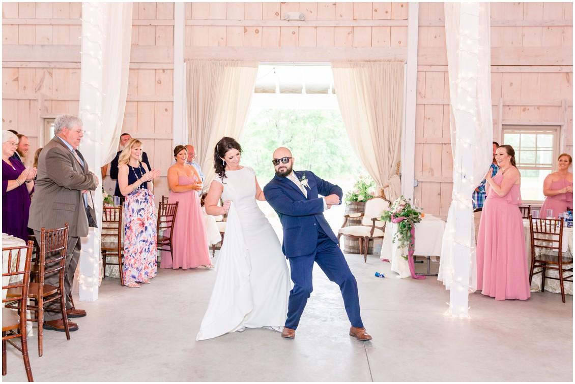 Bride and groom dance into their Kylan Barn wedding reception. | My Eastern Shore Wedding |