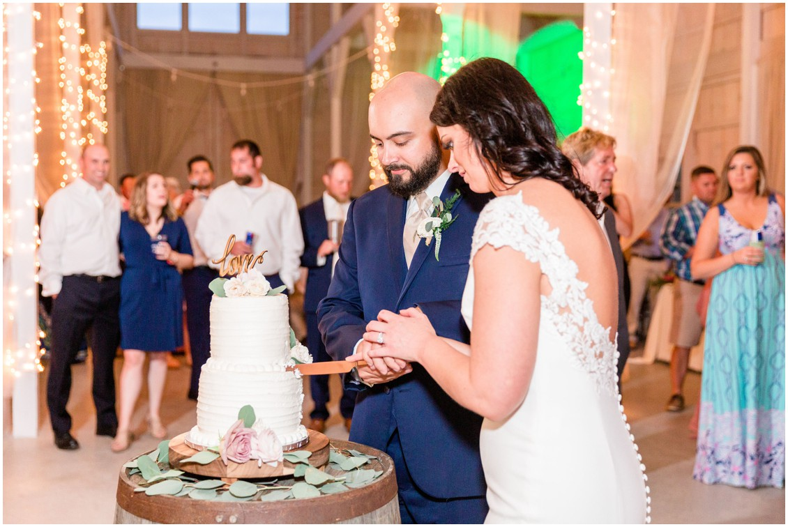 Bride and groom cutting their Country Cupcake wedding cake. | My Eastern Shore Wedding |