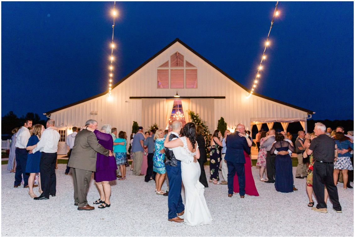 Bride and groom dance in front of Kylan Barn with the rest of their wedding guests. | My Eastern Shore Wedding |
