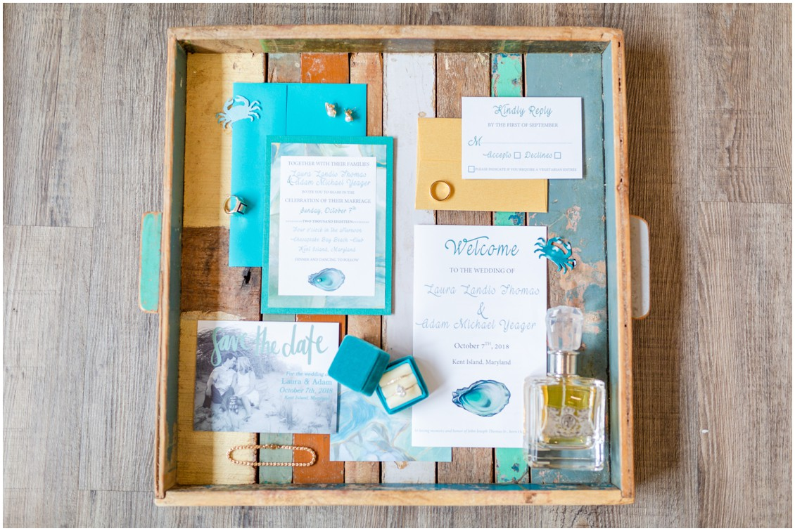 Blue and white wedding stationery on a rustic, wooden tray. | My Eastern Shore Wedding |