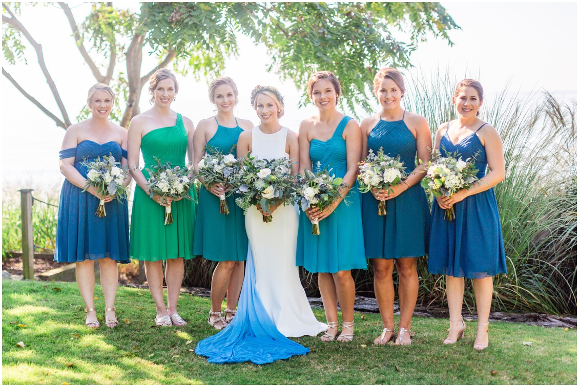 Bride with her bridesmaids, holding bouquets by Radebaugh Florist. | My Eastern Shore Wedding |