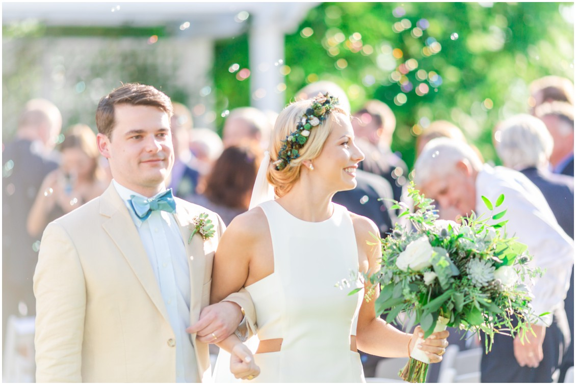 Bride and groom walk down the aisle together after getting married. | My Eastern Shore Wedding |