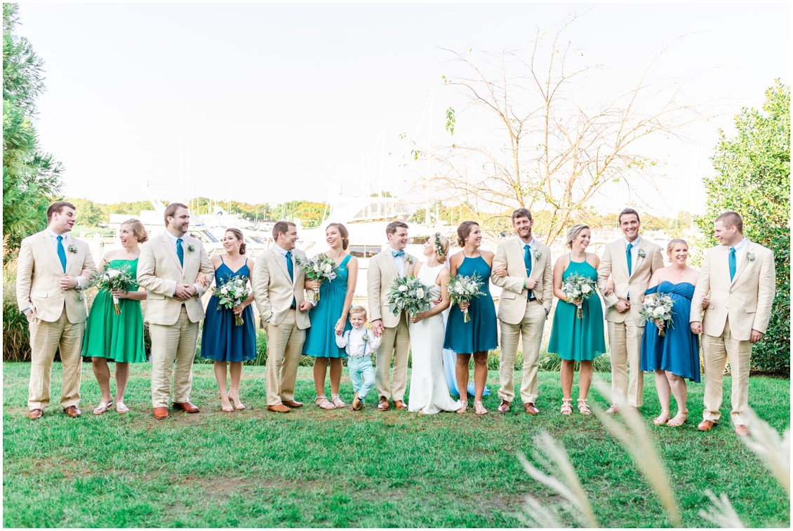 Bridal party together in front of the boats at Chesapeake Bay Beach Club. | My Eastern Shore Wedding |